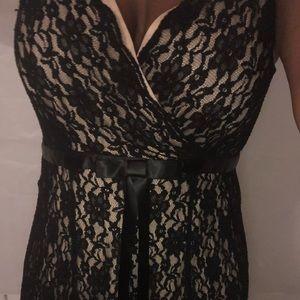 Sleeveless black and tan dress